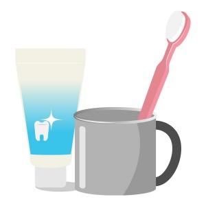 ピンクの歯ブラシと歯磨き粉